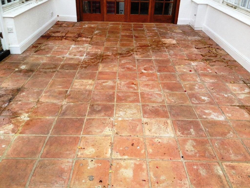 Abused Terracotta Tiled Conservatory Floor Before Cleaning in Kidlington