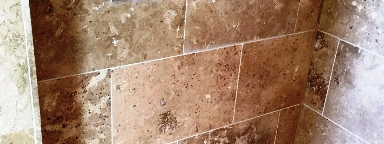 Damaged Limestone tiled en-Suite in West Hanney