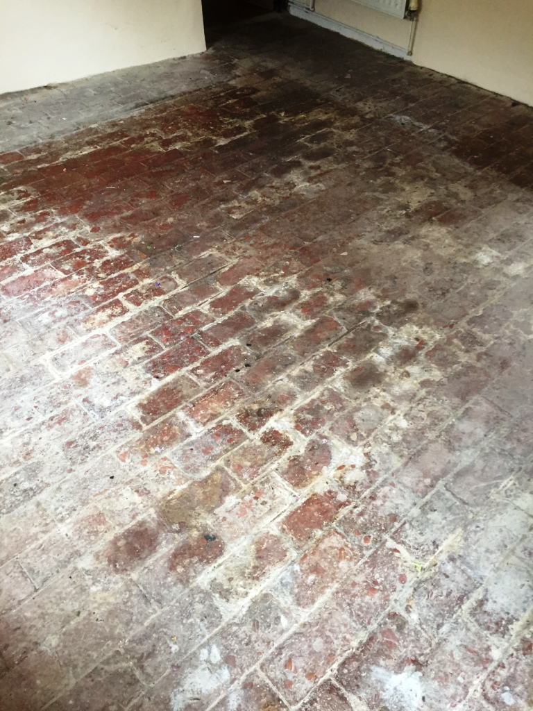 100 Year Old Brick Floor Before Cleaning